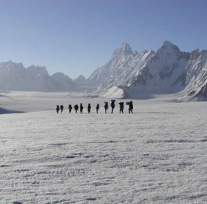 Group of Mountains Expert crossing the Biafo Hisper Pass , in the back ground Biantha Brrak. 7200m
