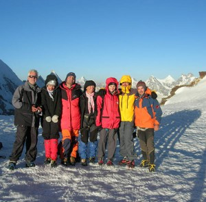 Trekkers enjoying the  sun rise on the top of Gondogoro Pass